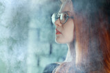portrait of a woman in a smoke, eyes in glasses / business concept, beautiful woman, sexy business girl. Stress, smoking, relaxed. - 212590222