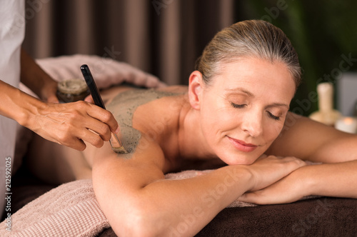 Leinwanddruck Bild Woman relaxing during mud treatment
