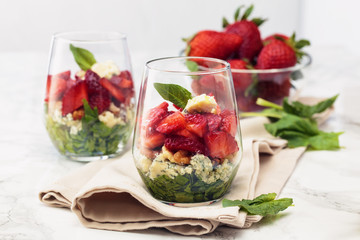 Spinach salad in glass.