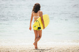 Surfing surfer woman girl walking holding surfboard. Water sport summer vacation travel concept. - 212597887
