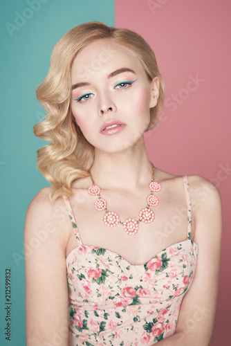Fotobehang womenART Blonde woman with color makup on colorful background