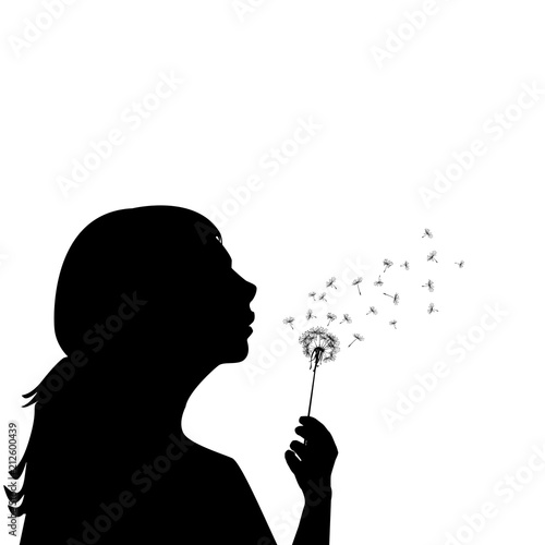 Fototapeta Silhouette of a little girl blowing dandelion