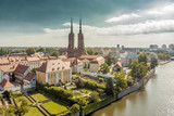 Poland. Wroclaw. Ostrow Tumski, park, and Odra River. Aerial 4K video.