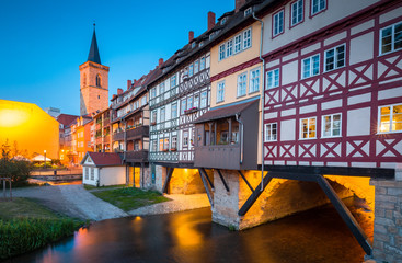 Historic city center of Erfurt with Krämerbrücke bridge illuminated at twilight, Thüringen, Germany