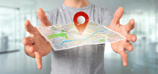 Man holding a 3d rendering pin holder on a map © Production Perig