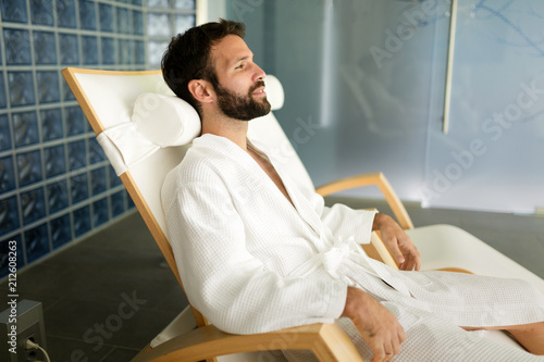 Fotobehang Spa Handsome man relaxing in chair at spa center