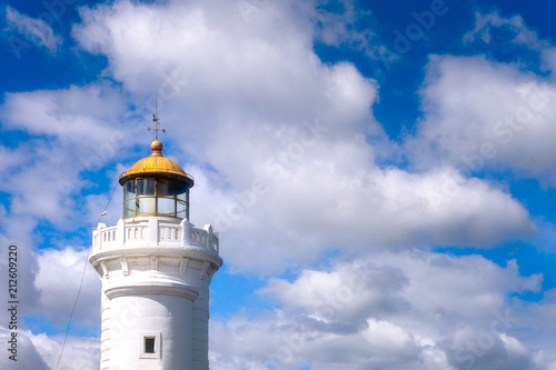 Fotobehang Vuurtoren Arriluze lighthouse in Getxo with blue sky with clouds at daylight