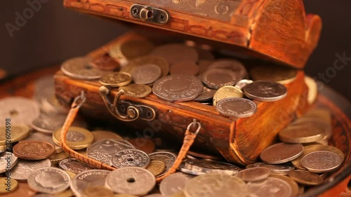 Treasure of gold coins - old trunk with gold coins