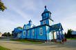 Leinwanddruck Bild - Blue wooden church in Narew, Poland