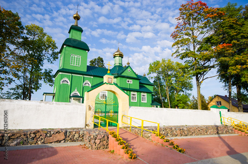Leinwanddruck Bild Green wooden church in Trzescianka, Poland