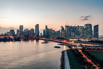 singapore skyline in evening time, view from open deck of a cruise ship © bob
