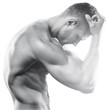 Young muscular fitness model with beautiful aesthetic body