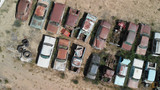 Old cars wreckage gathered in a park, aerial view - 212621654