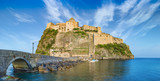 Sunset view of Aragonese Castle near Ischia island, Italy