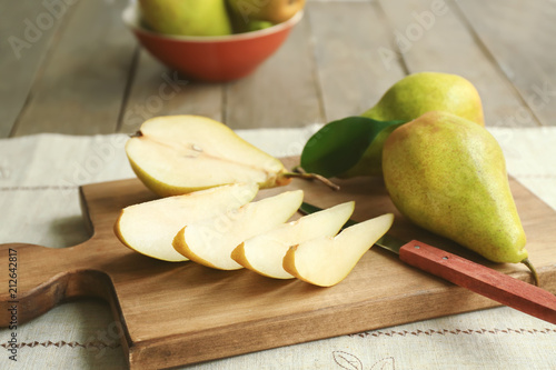 Cut pears on wooden board - 212642817