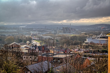 View over the town of Rotherham, including Rotherham United's New York Stadium, very industrial and urban under stormy grey sky