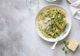 Pasta with pesto, green pea and parmesan. Overhead view, copy space - 212645234