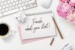 Leinwanddruck Bild - finish what you start - business concept. Notepad / ring binder, crumpled paper balls, mug with coffee and office supplies on a white feminine styled desktop, top view