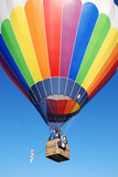 Colorful air ballon in a blue sky - 212653896