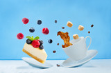 Flying cup of coffee with cheesecake - 212659690
