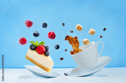 Fototapeta Flying cup of coffee with cheesecake
