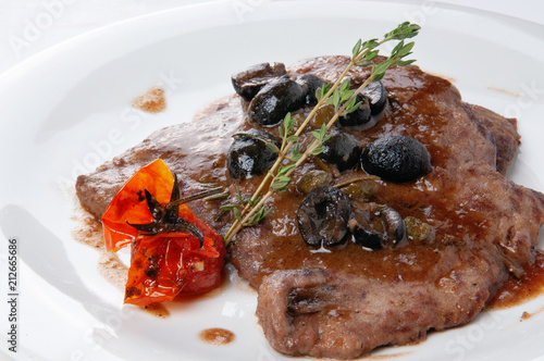 Fotobehang Steakhouse Meat steak with cherry tomatoes and olives and rosemary in sauce