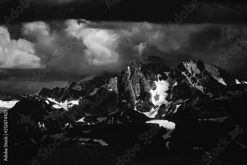 Aluminium Grijze traf. Beautiful nature landscape of snow mountains. Black and white monochrome toned. Telephoto zoom lens shot