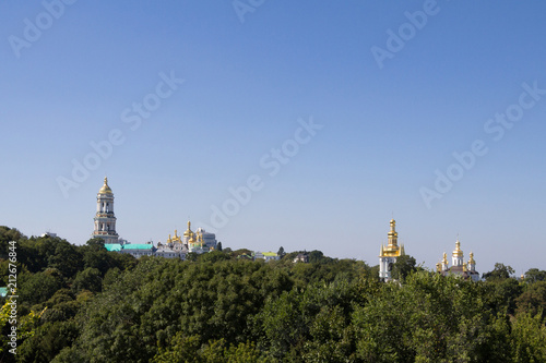 Fotobehang Kiev Panorama of Kiev Hills with a skyline made of the domes of Pechersk Lavra Monastery and churches, surrounded by a wood. it is one of the main landmarks of the city