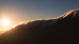 Beautiful nature landscape of mountains at golden sunset. Telephoto zoom lens shot