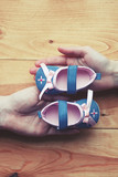 loving couple holding baby shoes with care and support - 212681645
