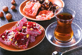 Traditional Turkish tea with traditional oriental sweet on brown  surface.Turkish desert-Rahat lokum. - 212684869