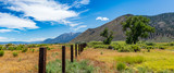 Fence line to the mountains - 212691437