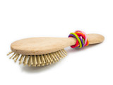 Rubber band and hair brush on white background. - 212696868