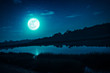 Leinwanddruck Bild - Night sky with full moon and many stars, serenity nature background.