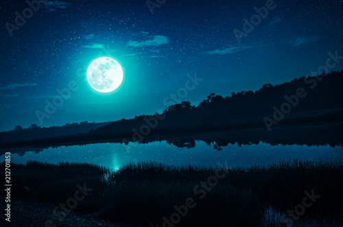Leinwanddruck Bild Night sky with full moon and many stars, serenity nature background.