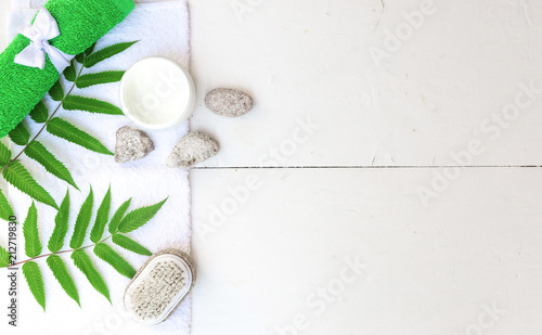Fotobehang Spa Spa beauty cosmetics on white marble table from above . Copy space. Flatlay. a jar of cream, leaves, flowers and a towel on a wooden background