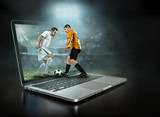 Caucasian soccer Players in dynamic action with ball  - 212721886