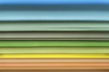 Colored sheets of paper side view rainbow concept