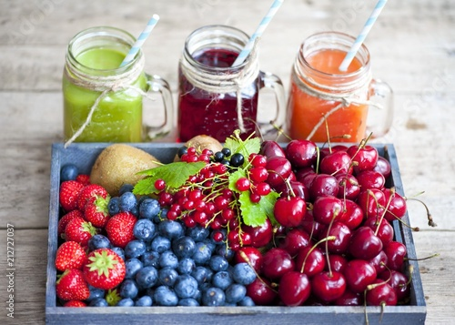 Foto Murales Homemade antioxidant summer fruits smoothie, berry juice assortment