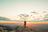 Mountain hiker at sunset