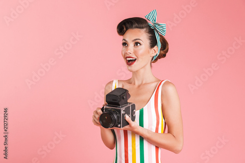 Foto Murales Portrait of a smiling brunette pin-up girl in plaid shirt