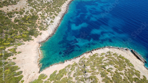 Fotobehang Tropical strand Aerial photo of tropical rocky seascape with beutiful turquoise clear sea and boats docked