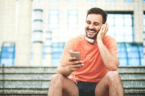 Man is enjoying music - 212730682