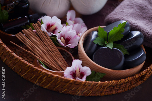 Fotobehang Spa spa setting with hibiscus flowers on brown