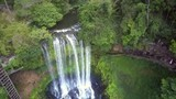 drone goes down to waterfall among lush jungle - 212752091