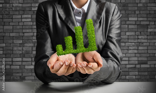 Businessman presenting growing graph.