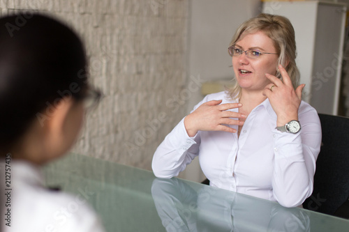 Foto Murales Confident blonde woman on job interview answering