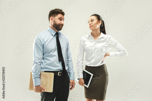 Wall mural Angry boss. Man and his secretary standing at office or studio