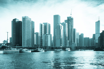 Chicago view of modern urban city skyline with office buildings and skyscrapers seen from the harbor at Lake Michigan