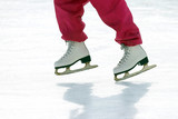 girl skates on ice rink.